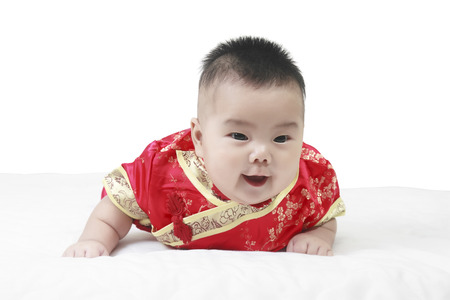 cheerful babies wearing cheongsam suit for Chinese New Year in studio