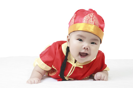 cheerful babies wearing Chinese New Year suit in studio
