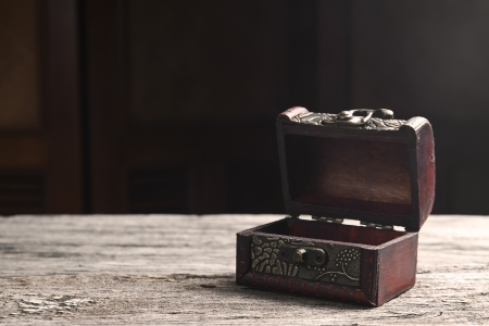 valuables: open treasure chest on old table for gift or keep valuables Stock Photo