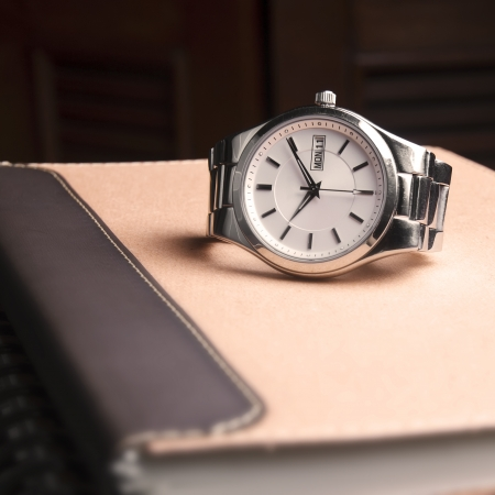 abstract silver watch on brown book Stock Photo