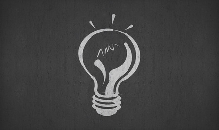 hand drawing light bulb on blackboard for your ideas Stock Photo