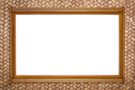 teak picture frame on rattan wall background, isolated