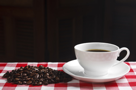 beans & fresh coffee in white cup on the table