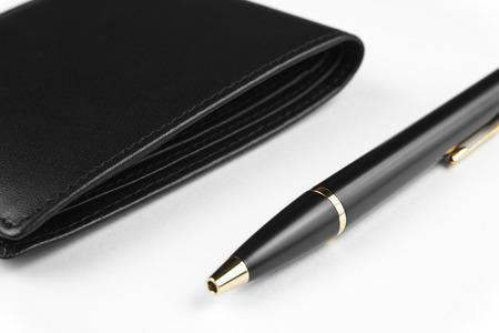 black wallet and pen on white Stock Photo