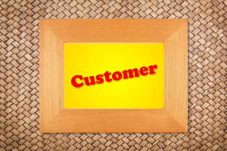customer text in modern picture frame on rattan wall background