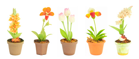 various fake flower sets in flowerpot on white background, isolated Stock Photo