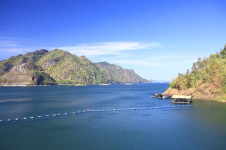 buoyancy: dam with raft and buoyancy on clear sky, use polarizing filter