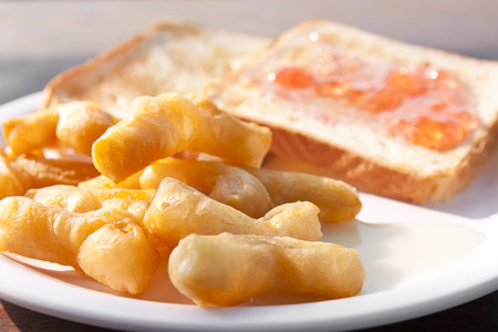 sweetened: deep-fried doughstick with sweetened condensed and bread for breakfast