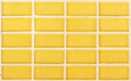 gele keramische wand voor achtergrond Stockfoto