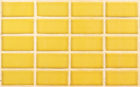 yellow ceramic wall for background Stock Photo