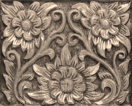 floral carving on golden teak