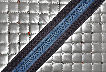 silver leather texture with diagonal zipper for background