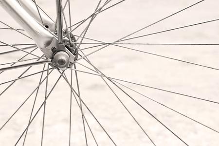 Details of retro bicycle wheel, sepia tone