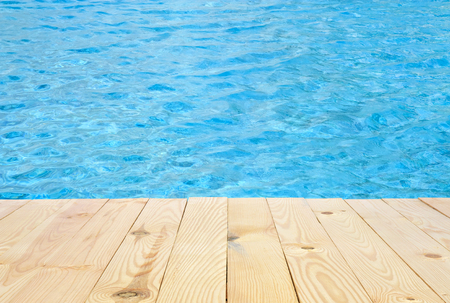 swimming pool and wooden deck in the hotel or resort for travel at summer holiday Stock Photo