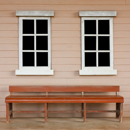 chesterfield: old wood white window with black screen on the wall with long chair or chesterfield vintage cowboy house style scene for background included clipping path for black screen on the window Stock Photo