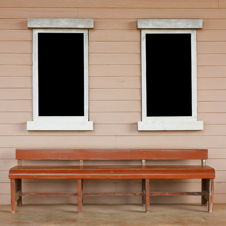 chesterfield: dual or two old wood white window with big black screen on the wall with long chair or chesterfield vintage cowboy house style scene for background included clipping path for black screen on the window Stock Photo