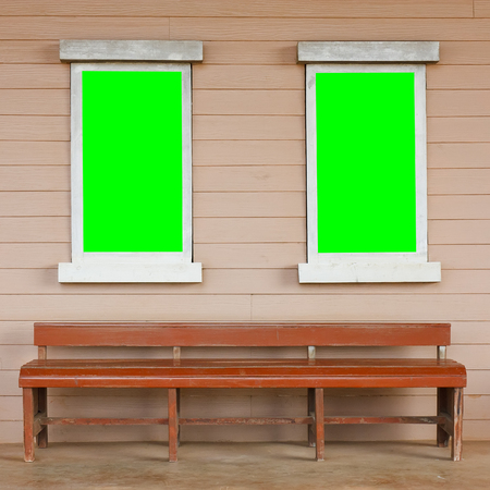 chesterfield: dual or two old wood white window with big green screen on the wall with long chair or chesterfield vintage cowboy house style scene for background included clipping path for green screen on the window