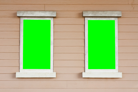 vdo: dual or two old wood white window with big green screen on the wall vintage cowboy house style scene for background included clipping path for green screen on the window for your idea Stock Photo