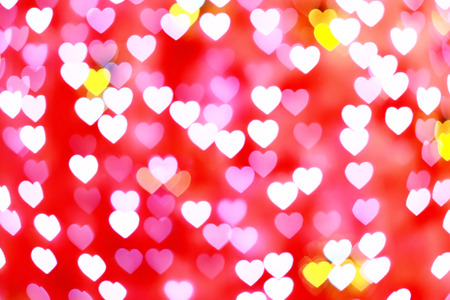 abstract pink and red defocused heart bokeh for love or valentine day background