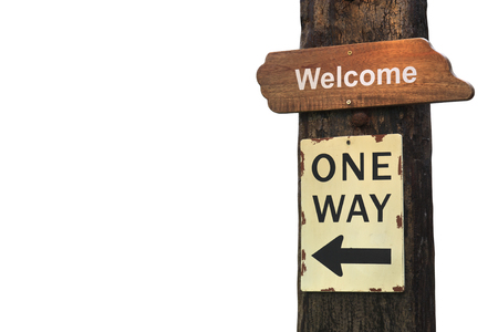 vintage wood welcome plate or signboard with one way guide post on old wooden pole and white background isolated included clipping path