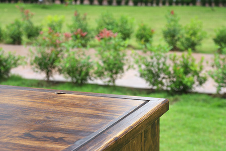 top view empty vintage wood table at 45 or forty-five degree on nature garden background for place or put your object