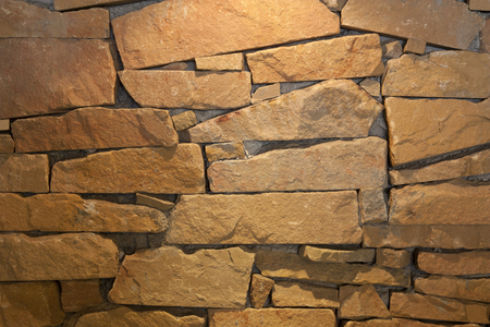 old and vintage yellow granite or stone wall or floor at archaeological or historic site for background
