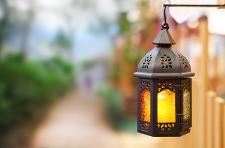 old vintage lantern or classic lamp and warm white light for interior or exterior architecture at home garden or hotel and resort fence on nature with space Stock Photo