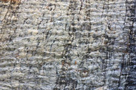 stone or rock wave texture gray and yellow wall on mountain cliff for background or wallpaper
