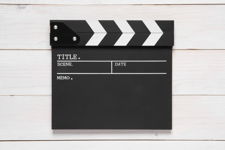 blank clapper board on top view vintage white wood table for the action scene or filming and shooting movie or cinema production