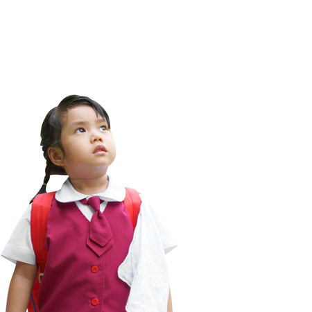 Asian children or kid girl student wear school uniform thinking new idea and back to school or kindergarten for study or learning education with looking ahead for future or miss on white clipping path