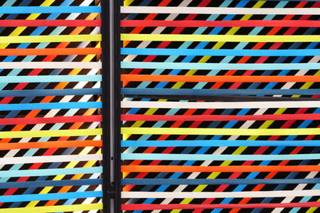 abstract colorful and multicolored background from rainbow ribbon wall or interior ceiling frame and wallpaper partition for creative art design and battens scene