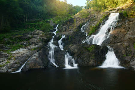 waterfall clear water on winter season for holiday relax and summer vacation with tree and stone or rock in jungle or forest at Khlong Nam Lai waterfall floor 2 for nature landscape in national park Foto de archivo