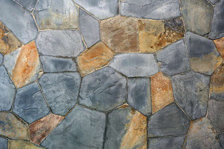 old stone or rock wall and vintage brown gray granite floor or black yellow jigsaw table for background or backdrop and wallpaper Banque d'images