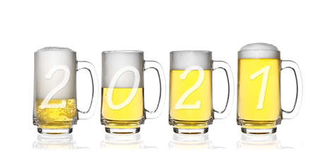Happy New Year 2021 number and Merry Christmas cheers on frosty lager light beer and white bubbles in clear glass with handle and steam for winter drink or celebration isolated on white background Stockfoto