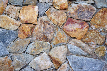modern old hard stone stack or rock wall and vintage brown gray granite floor or black yellow jigsaw on top view for strong background or texture backdrop and wallpaper with architecture construction Stockfoto