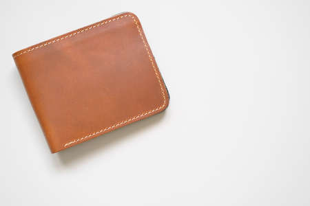 brown stitched wallet men or whiskey color and cow leather for put money and card on top view white table or background isolated with copyspace