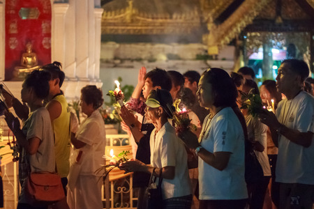 walk in: Walk with lighted candles in hand around a temple