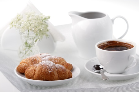 Breakfast with coffee and croissant photo