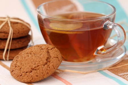 Oats cookies and a cup of tea photo