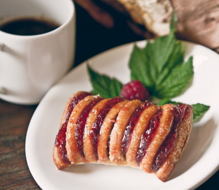 Strudel with raspberry and coffee photo