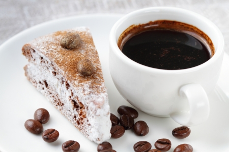 Chocolate cake and cup of coffee photo