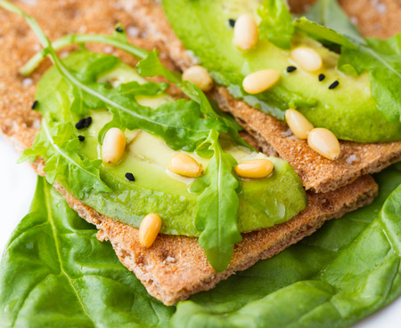 Crispbread with avocado and arugula photo