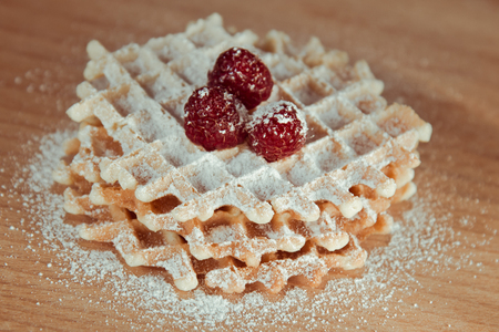 powdered: Waffles with raspberries and powdered sugar Stock Photo