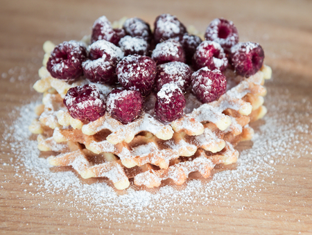 Waffles with raspberries and powdered sugar Stock Photo