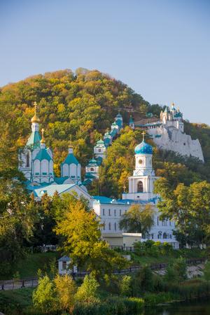 donetsk: Orthodox church in Svyatogorsk, Donetsk Region, Ukraine, autumn landscape