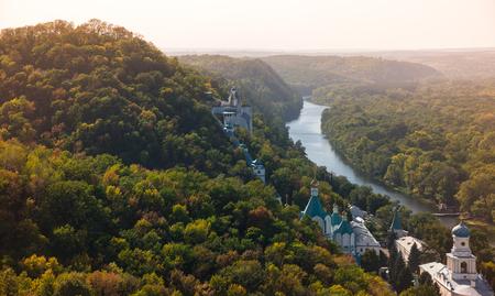 virgil: Orthodox church in Svyatogorsk, Donetsk Region, Ukraine, autumn landscape