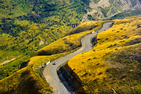 twisting: The twisting road in the mountains. Road snaking through landscape