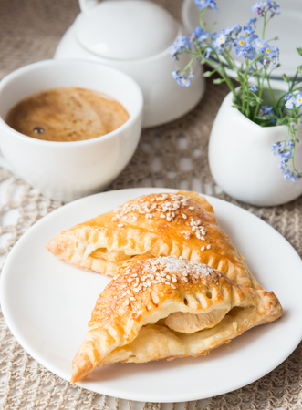 drink me: Samosa with apples and cup of coffee