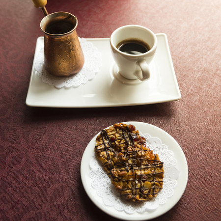 Cookies with nuts and chocolate and turkish coffee serve