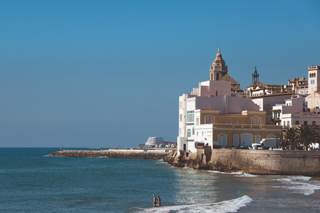 SITGES, CATALONIA, SPAIN - SEPTEMBER 29, 2016: View on the Church of Sant Bartomeu and Santa Tecla in Sitges